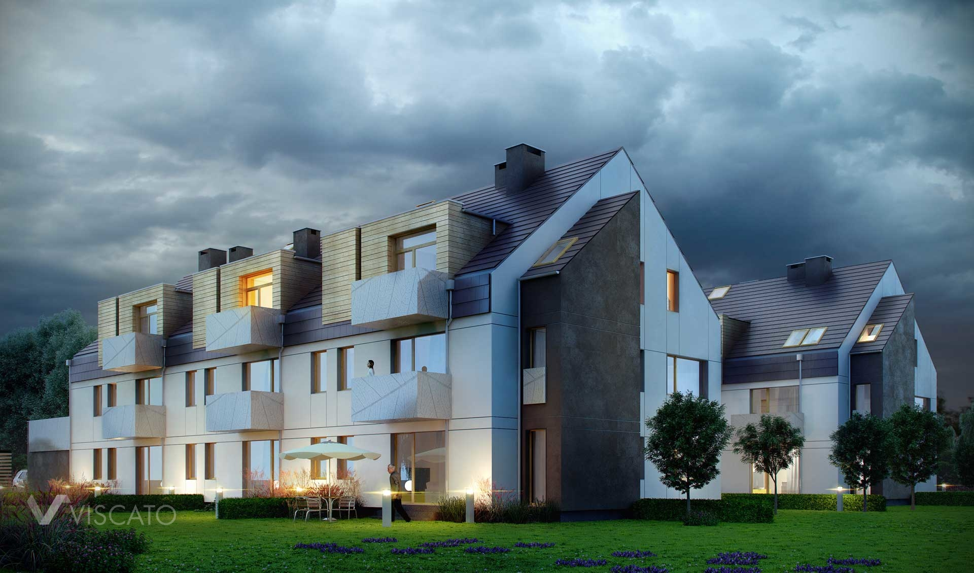 3d Visualization of real estate in Kamieniec Wrocławski. View, in night time, is showing both of buildings, backyard with lights on, small trees and flowers on meadow.