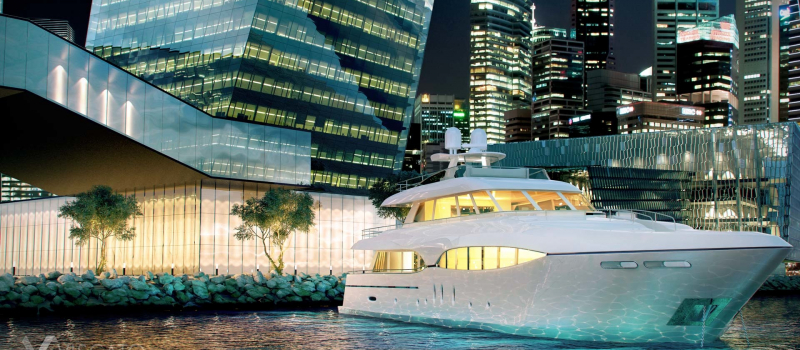 3d model of yaht on singapore bay with skyscrapers in background. Visualization by night.